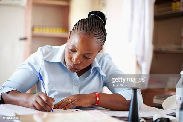 female doctor filling medical documents - hugh sitton stock pictures, royalty-free photos & images