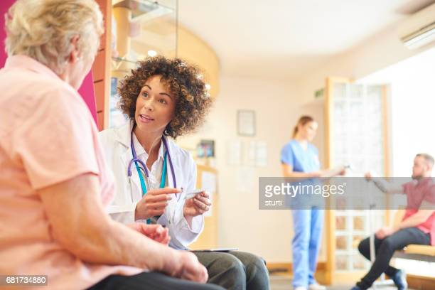 Female doctor giving advice to senior patient