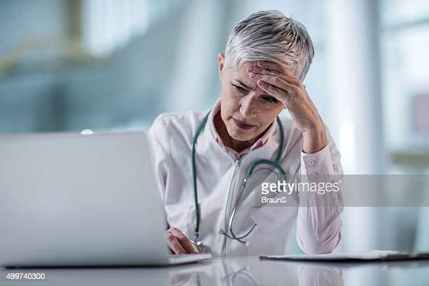 Female doctor having a headache while being at doctor's office.