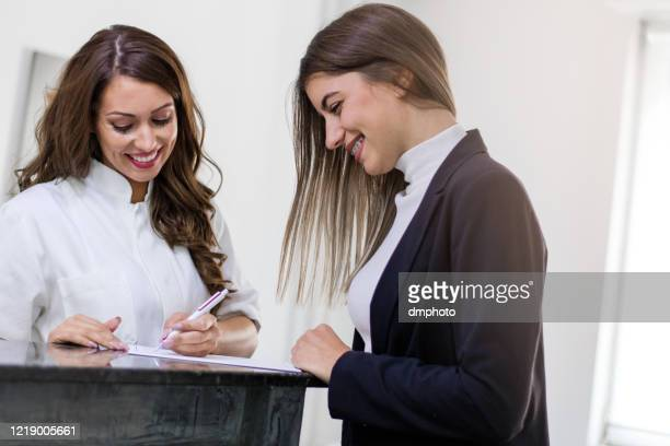 female doctor having conversation with patient - serene people stock pictures, royalty-free photos & images