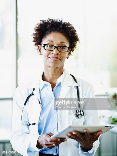 Female doctor holding digital tablet in hospital