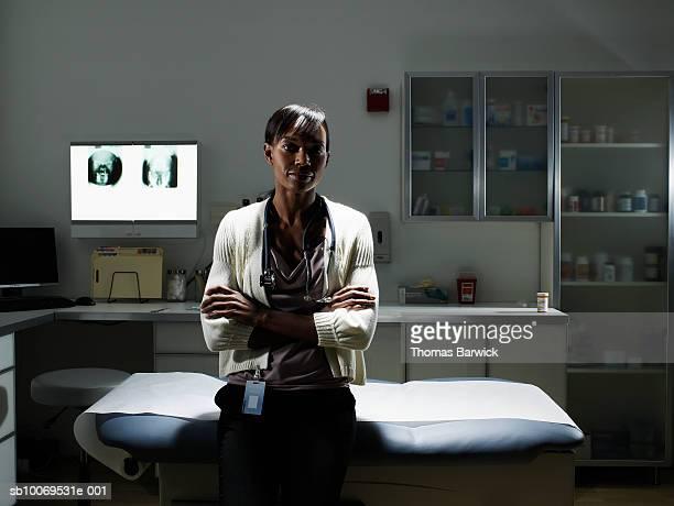 Female doctor in examination room smiling, portrait