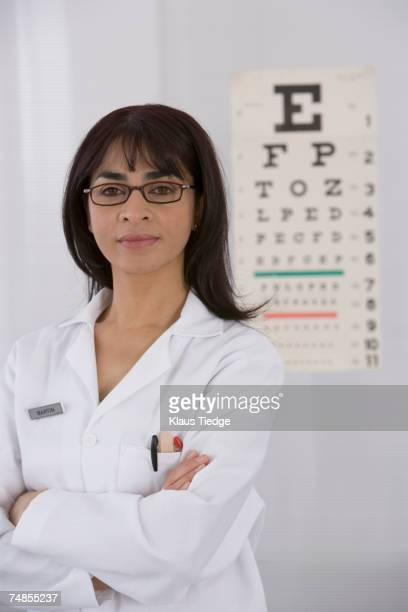 Female doctor in front of eye chart