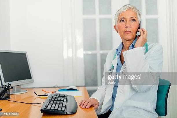 Female Doctor In Her Office.