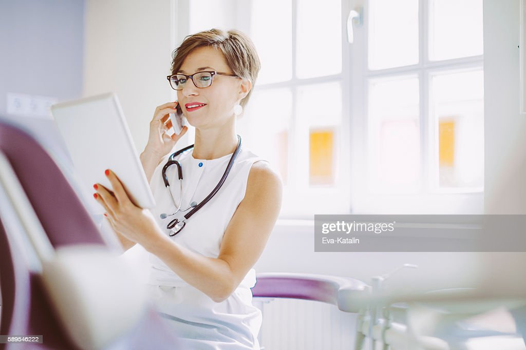 Female doctor is working in the surgery : Stock Photo