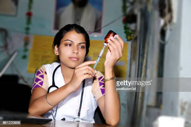 Female doctor preparing injection in clinic