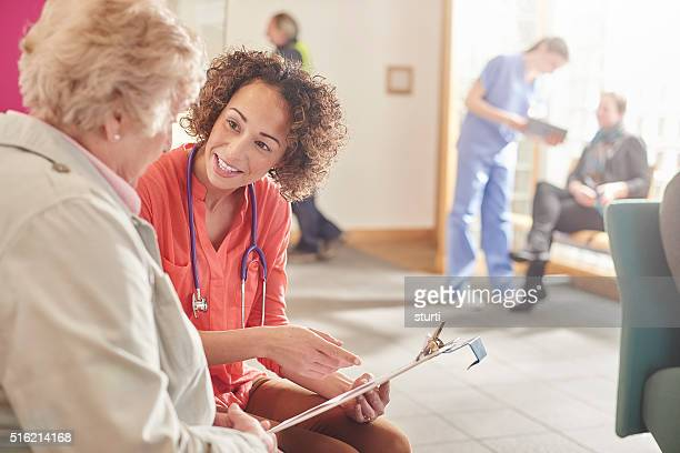 female doctor questionnaire - form filling stock pictures, royalty-free photos & images