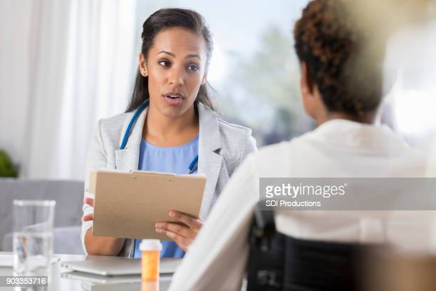 Female doctor reviews patient's medical diagnosis