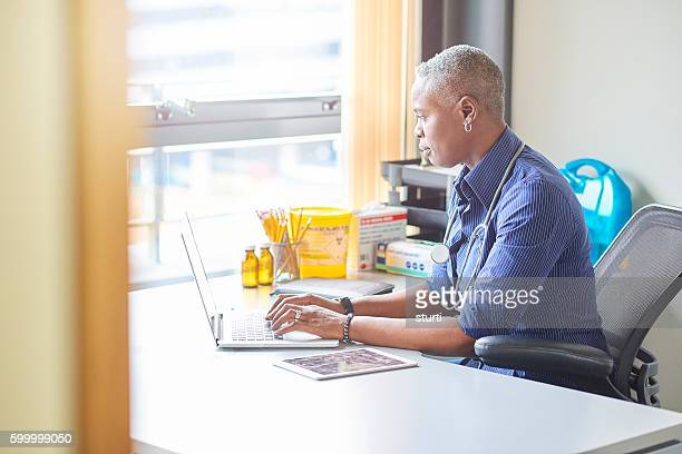 female doctor sitting at her desk