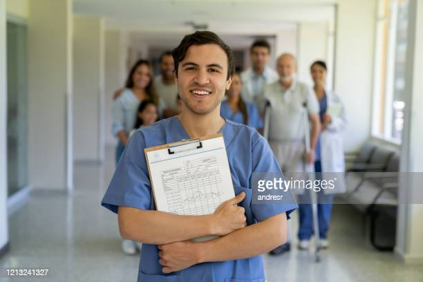female doctor smiling at the hospital - civilian stock pictures, royalty-free photos & images