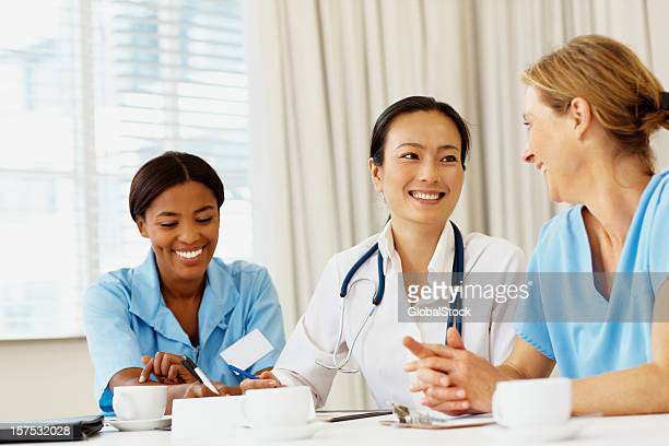Female doctor smiling during at a meeting