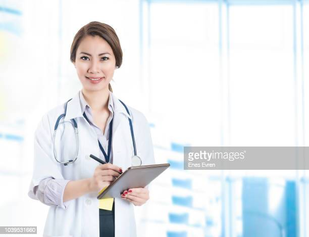 Female Doctor taking notes on a digital tablet
