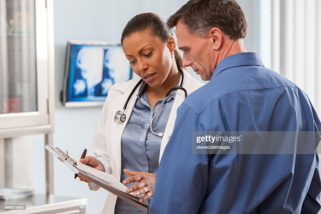 Female doctor talking with patient. : Stock Photo