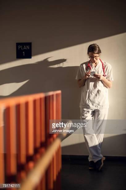 Female doctor using smartphone