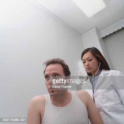 Female Doctor Using Stethoscope On Mans Back Low Angle ... Doctor Stethoscope On The View