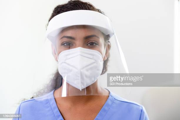 female doctor wears ppe in covid-19 unit - frontline worker stock pictures, royalty-free photos & images