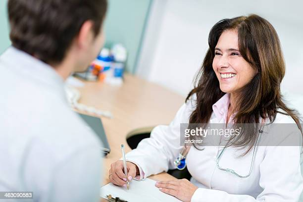 Female doctor with a patient