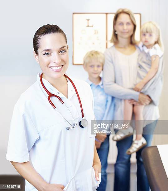 female doctor with family in clinic - patients brothers stock pictures, royalty-free photos & images
