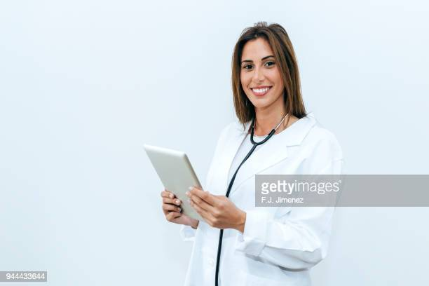 Female doctor with tablet on white background