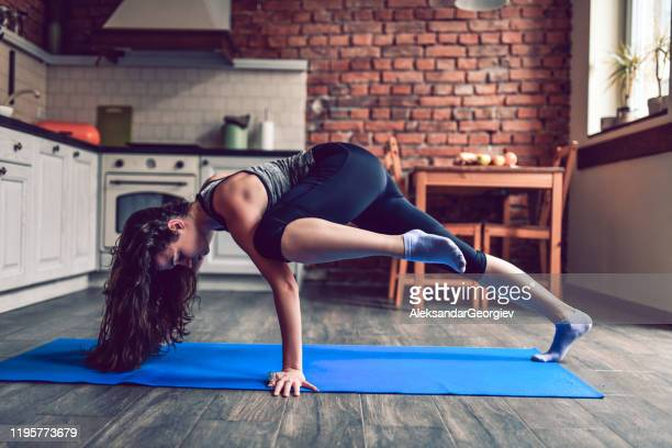 female doing cardiovascular exercises in kitchen - human arm stock pictures, royalty-free photos & images