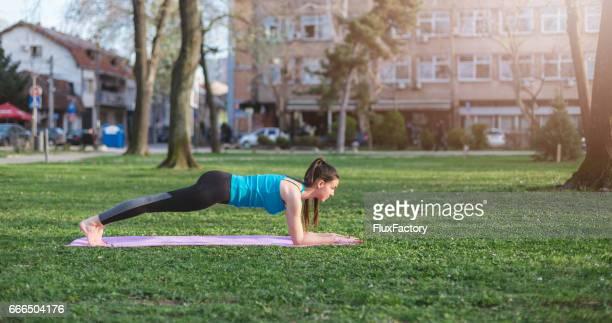 Female doing push ups on an exercise mat