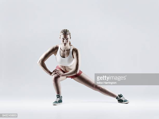 Female doing side lunge as part of her exercise.