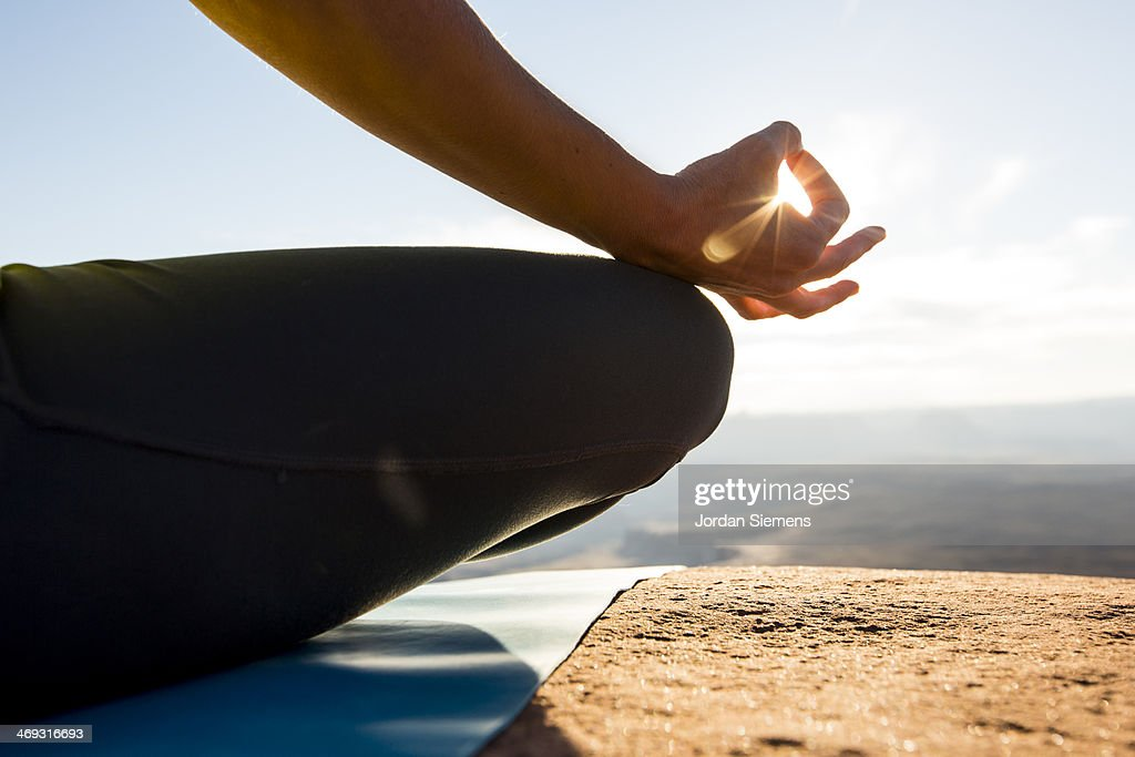 Female doing yoga and meditation outside : Stock Photo
