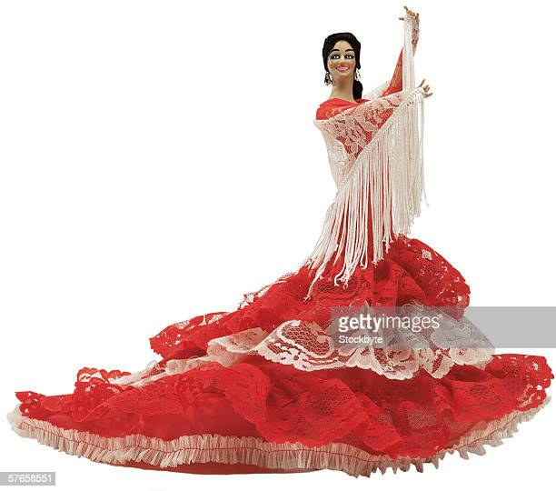 female doll dancing in a gown