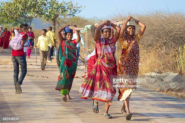 "Female 'Doolie' workers carry a Jain pilgrim up Mount Satrunjaya meaning ""place of victory"", Palitana on MARCH 2, 2012. The temples, shrines and..."