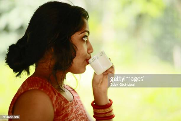 Female Drinking Coffee