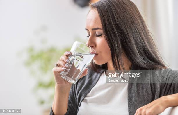 female drinks water from a glass. - thirsty stock pictures, royalty-free photos & images