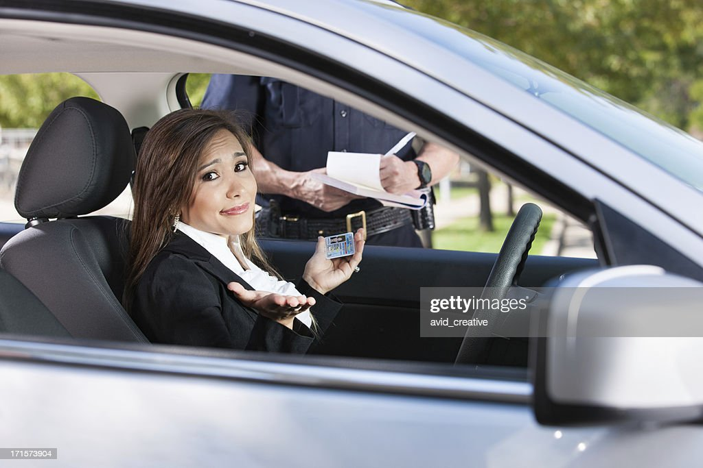 Female Driver Receiving Citation From Police : Stock Photo