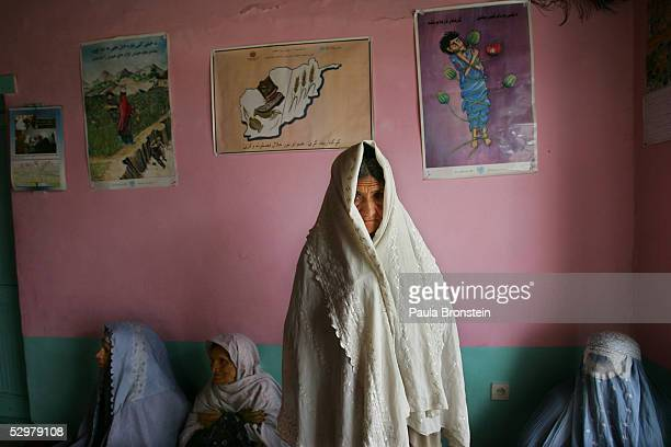A female drug addict stands next to a antidrug posters along with other women at the Nejat Center women's community based drug rehabilitation program...
