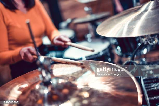 female drummer hitting the cymbals - pop music stock pictures, royalty-free photos & images