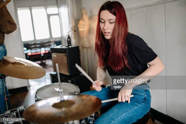 female drummer on rehearsal - drum percussion instrument stock pictures, royalty-free photos & images