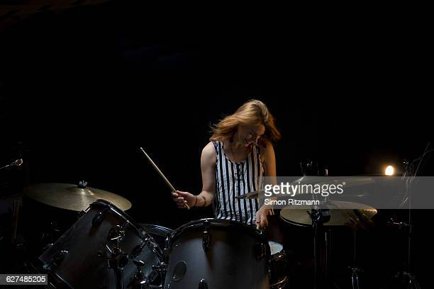 Female drummer performing on stage