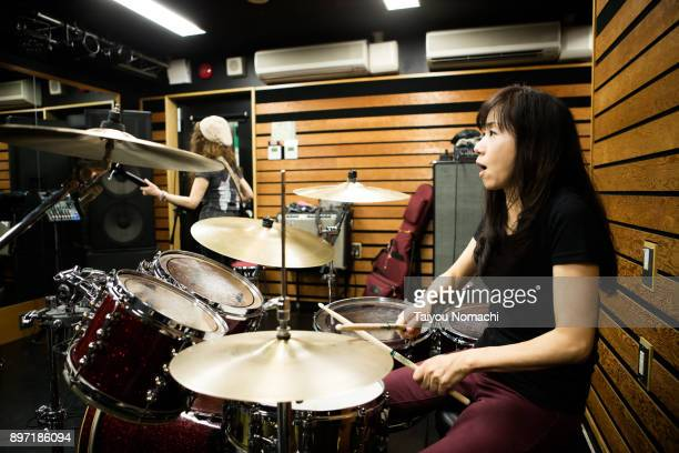 female drummer - percussion instrument stock pictures, royalty-free photos & images