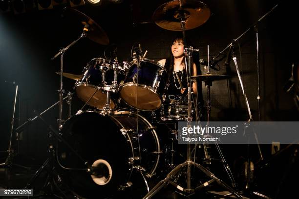 a female drummer who performs at the stage - maxim musician stock photos and pictures