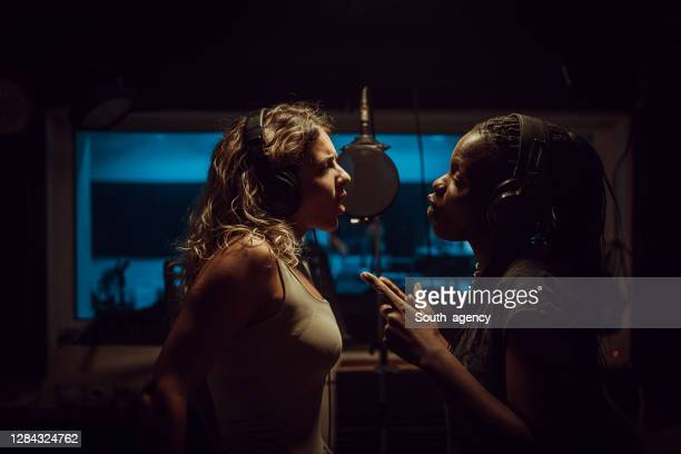 female duet recording song in music studio - soul music stock pictures, royalty-free photos & images