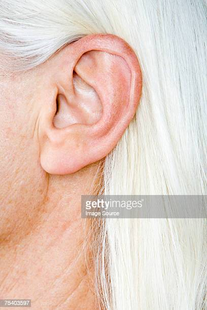 female ear - ear stock pictures, royalty-free photos & images