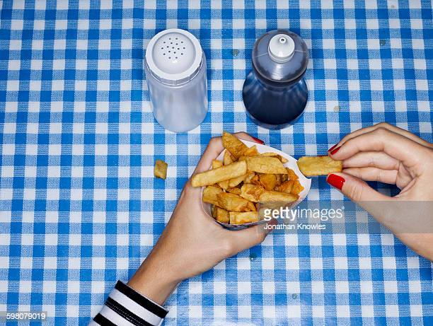 Female eating chips with salt and vinegar