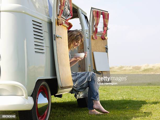 Female eating Soup in Camper Van