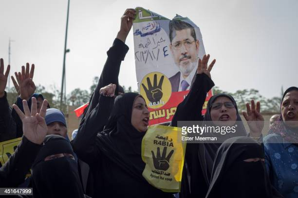 Female Egyptian supporters of ousted president Mohamed Morsi and of the Muslim Brotherhood protest outside the Police Academy in New Cairo on the...