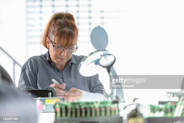 female electrical engineer in cable finishing factory - monty rakusen stock pictures, royalty-free photos & images