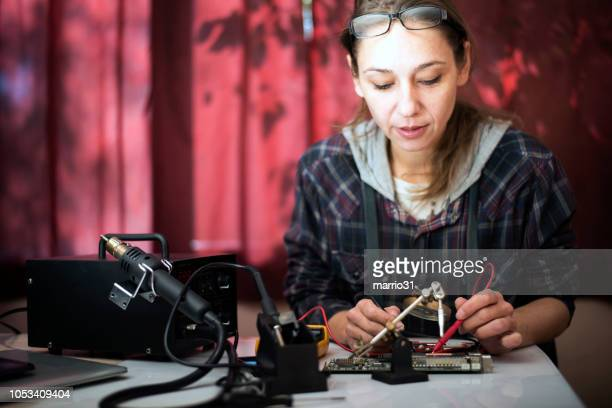 female electronic engineer checking circuit board - oscilloscope stock pictures, royalty-free photos & images