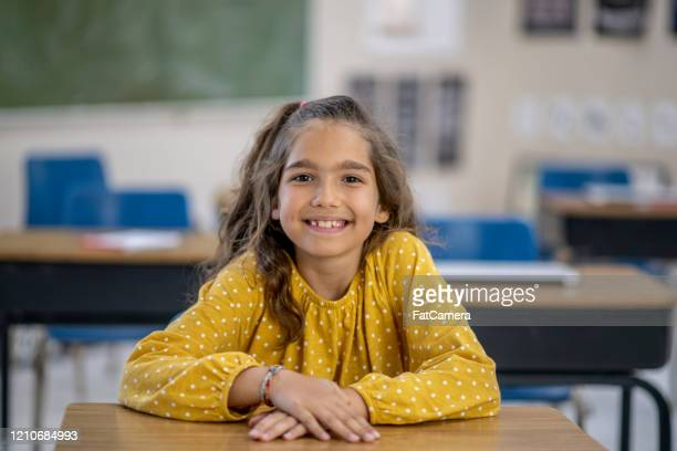 female elementary student portrait stock photo - spelling stock pictures, royalty-free photos & images