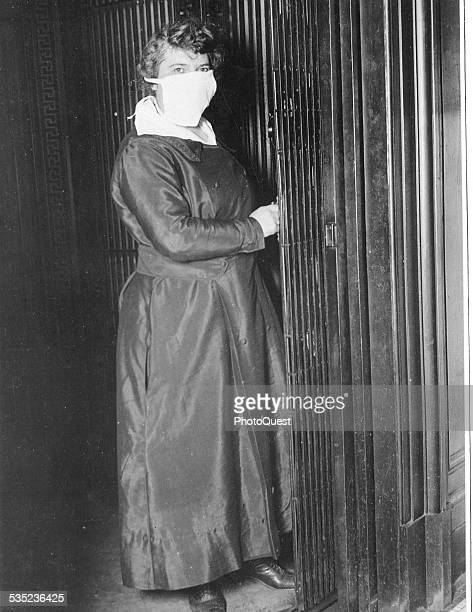 Female Elevator operator in New York City NY wearing a mask to protect against Spanish flu New York October 16 1918