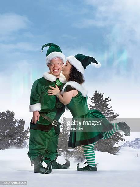 female 'elf' kissing male 'elf's' cheek, portrait (digital composite) - enano fotografías e imágenes de stock