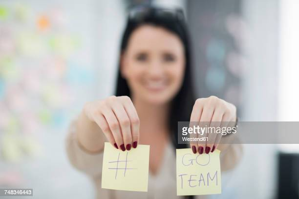 Female employee with two post it stickers