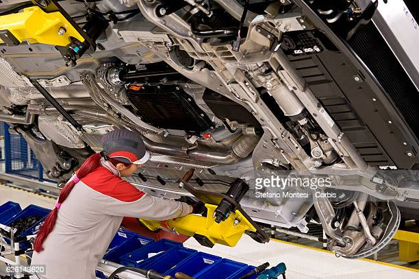 A female employee works in the Assembly Lines where they assemble the Alfa Romeo Giulia in the Cassino Assembly Plant FCA Group In this area it takes...